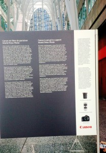 Exhibit panel with information on Canon's role in the World Press Photo exhibition.